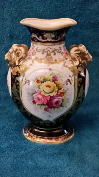 A stunning hand painted and gilded Noritake twin Ram head handled vase $35.00