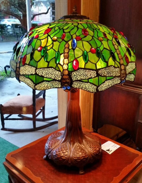 Beautiful Tiffany style stain glass lamp with heavy cast iron base and paw foot $275.00