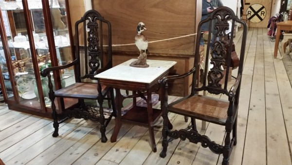 Pair of Antique heavily carved arm chairs with claw feet and cane seat. Beautiful original patina.