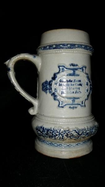 "Whites Utica Embossed Stoneware Mug with Revolutionary Scene and German Motto 8 1/2"" H, 5"" DIA"
