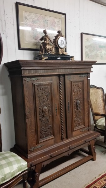 20th century Jacobean style beautifully carved cupboard on natural oak stand