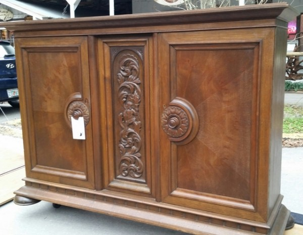 Ornately carved Renaissance buffet side cabinet with great Storage. Drawers and shelves inside with 2 locking doors. Has working locks and original key. Imported from Denmark.