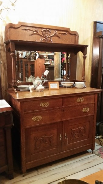 Eastlake victorian quartered oak server buffet with beveled mirror, carved backsplash, and knapp joint construction.