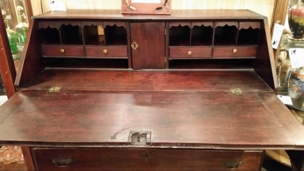 18th Century mahogany Chippendale slant top desk with ogee bracket base, Loper writing lid supports, a full interior of drawers including three hidden drawers, cubbies & a private door. Wear consistent with age and use.